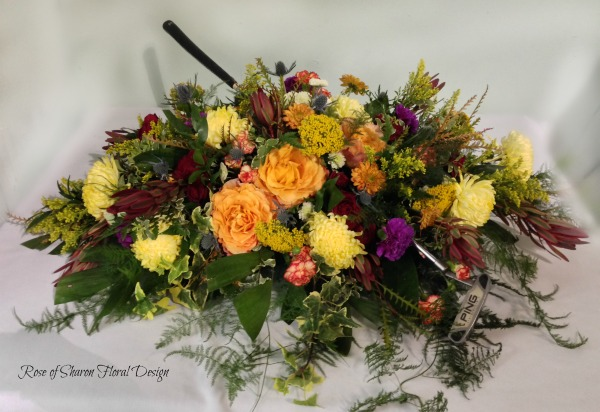 Mixed fall casket spray with golf club