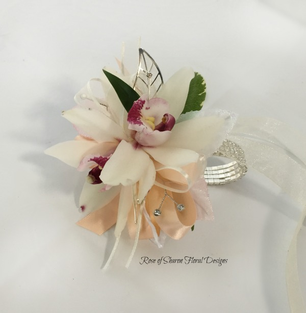 Peach orchid corsage