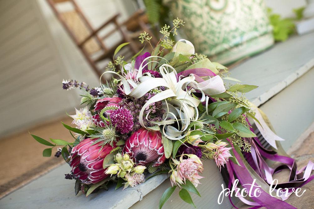 PhotoLovePhotography. Plum protea bouquet