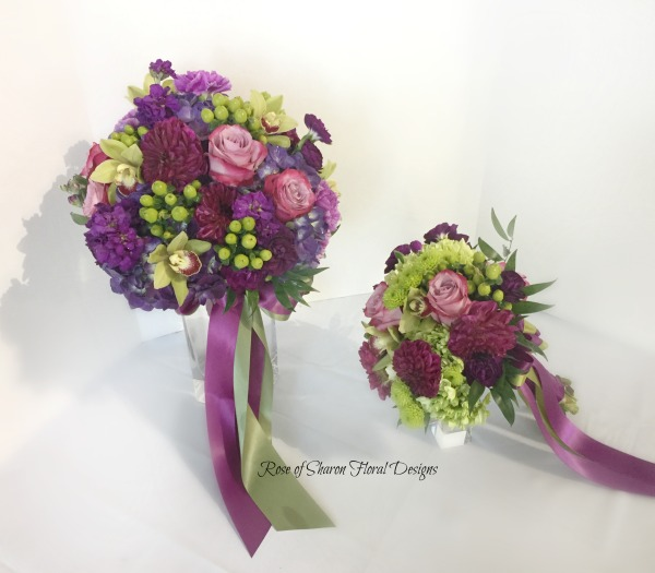 Hand-tied purple & green bride's bouquet & bridesmaid bouquet. Roses, orchids, stock, hydrangeas. Rose of Sharon Floral Designs