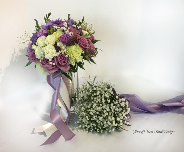 Purple & white hand-tied bride's bouquet with baby's breath bridesmaid bouquet. Rose of Sharon Floral Designs