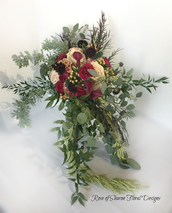 Cascading organic bouquet with roses, scabiosa, eucalyptus & mixed foliage. Rose of Sharon Floral Designs