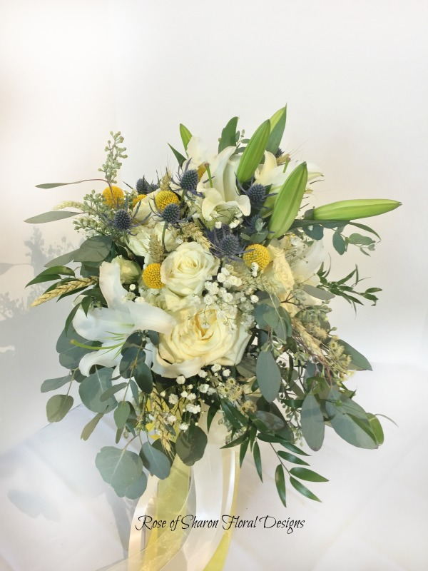 Close up: Semi-organic yellow & white bouquet with lilies, garden roses, billy balls & eucalyptus. Rose of Sharon Floral Designs