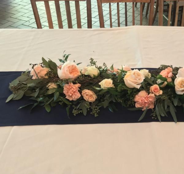 Seeded eucalyptus + silver dollar eucalyptus + garden roses, roses & carnations $65/ft