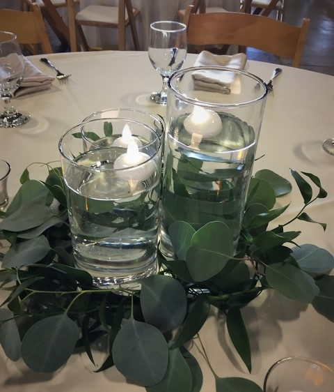 16. Eucalyptus + candle centerpiece. Rose of Sharon Floral Designs.jpg