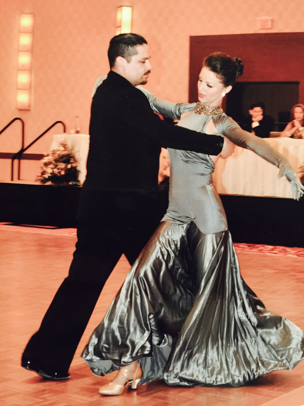 Here is a shot of Mr. Perez and me dancing a waltz for an exhibition. Photo was taken by a student-Ms. Flynn. Looking up was added to the list right under arm styling :)