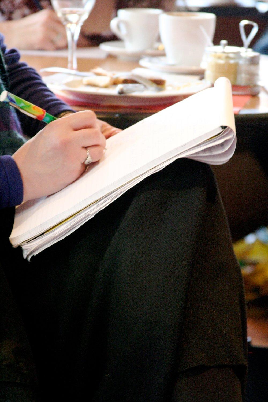 Woman blue dress writing.jpg