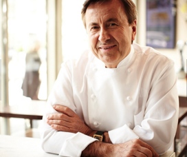 Chef Daniel Boulud at Epicerie Boulud - light and airy, dressed in a Chef's Coat