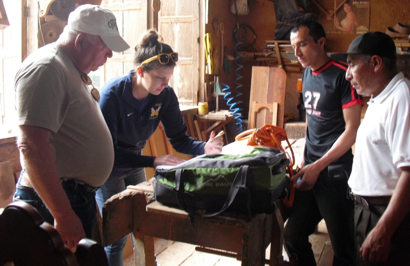 Natalie going over OHorizons' Wood Mold Construction Manual with members of Rotary's Clean Water Ecuador Team.