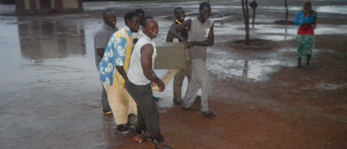 The community produced 8 BioSand Filters that are still being used daily. Here they're transporting a filter to its home.