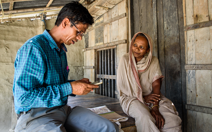 Our project manager Ranajit sits down with a filter owner to ask her survey questions, which he then plugs into the MWater App on his cell phone. Each of our water filters is geo-tagged and has extensive user and performance data tracking associated with it.
