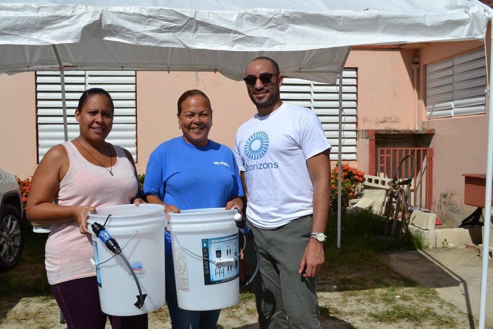 OHorizons_Team_Member_Chris_Pinderhughes_Stands_with_Punta_Santiago_Water_Filter_Recipients.jpg