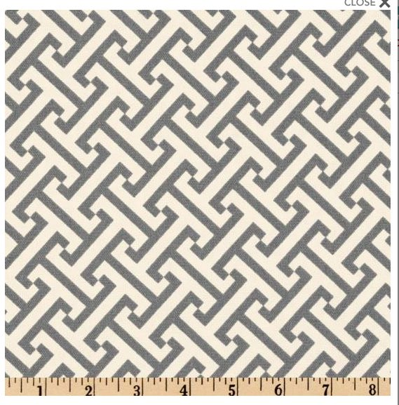 A Waverly graphic trellis fabric in gray and off-white
