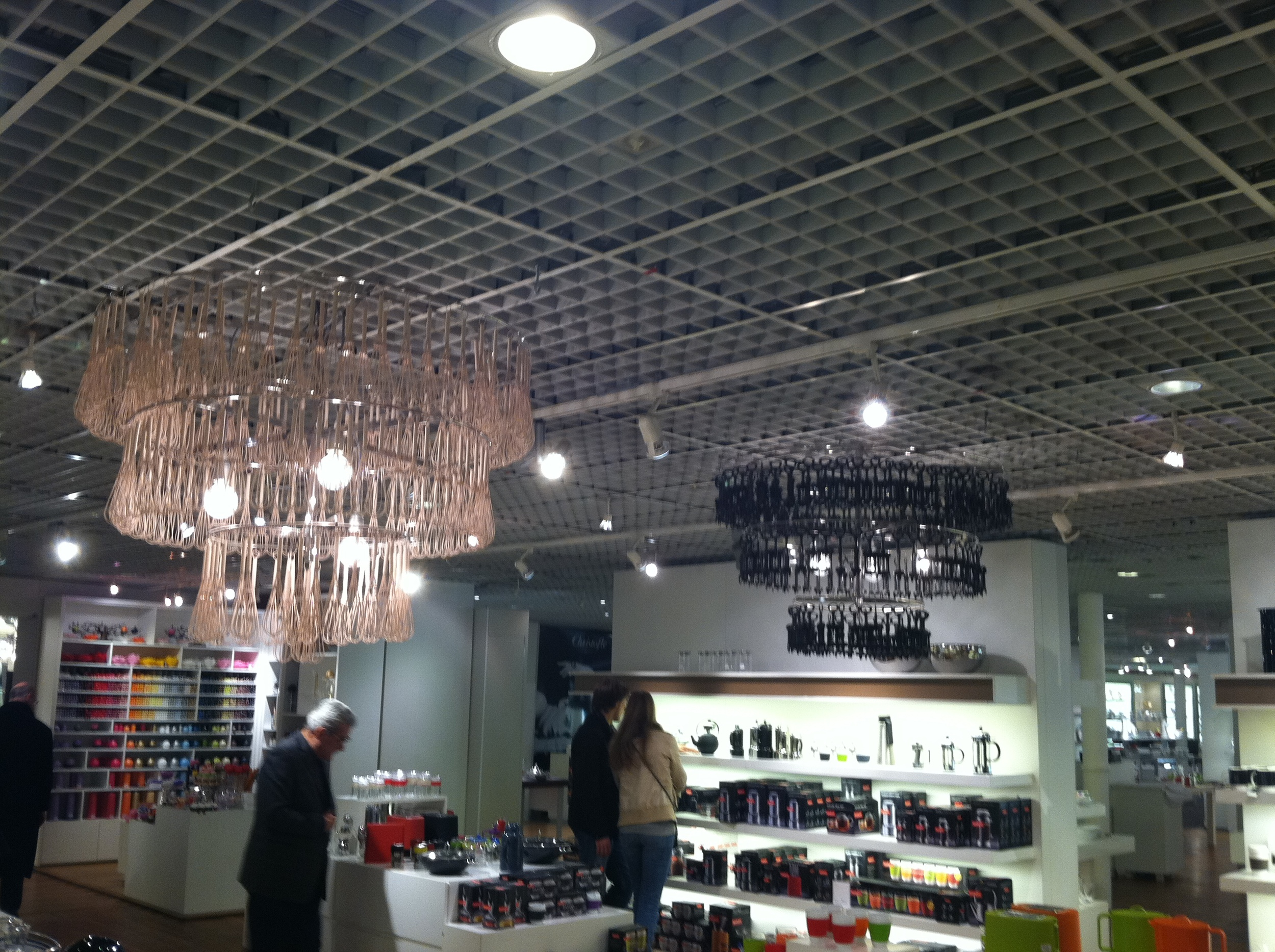 Large chandeliers made out of whisks inside Le Bon Marche