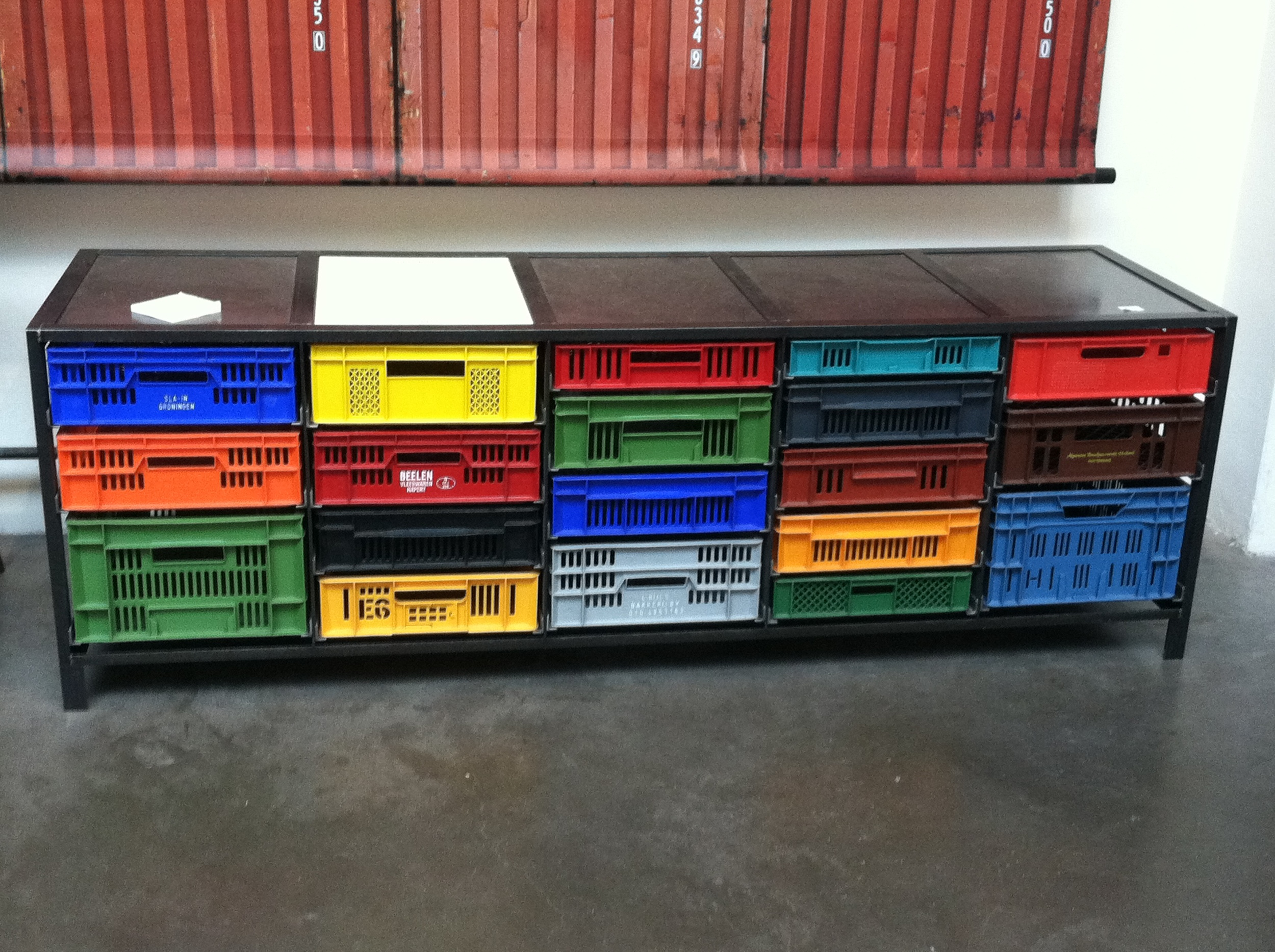 Repurposed plastic crates and steel console in Merci