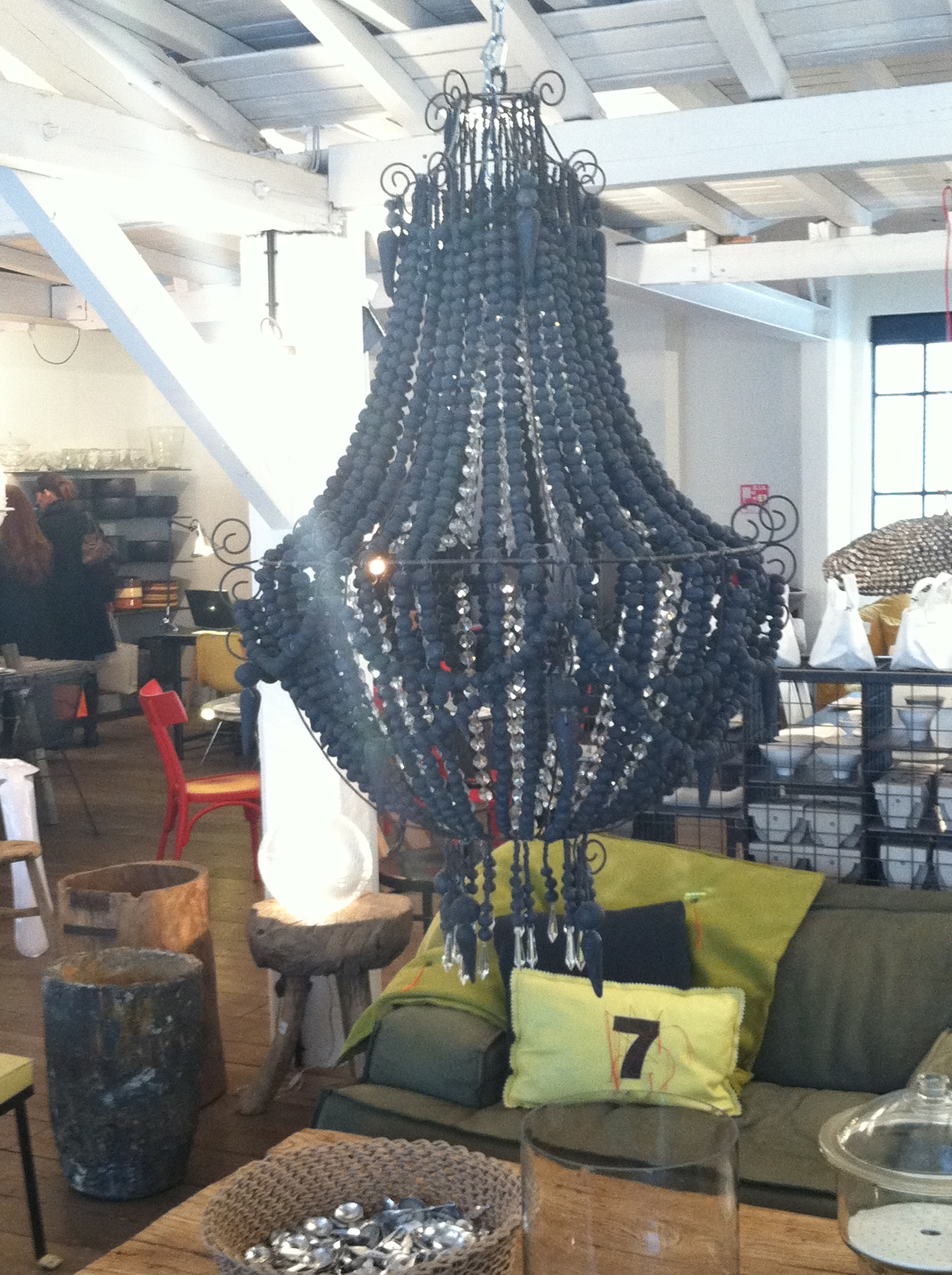 Dramatic black beaded chandelier inside Merci