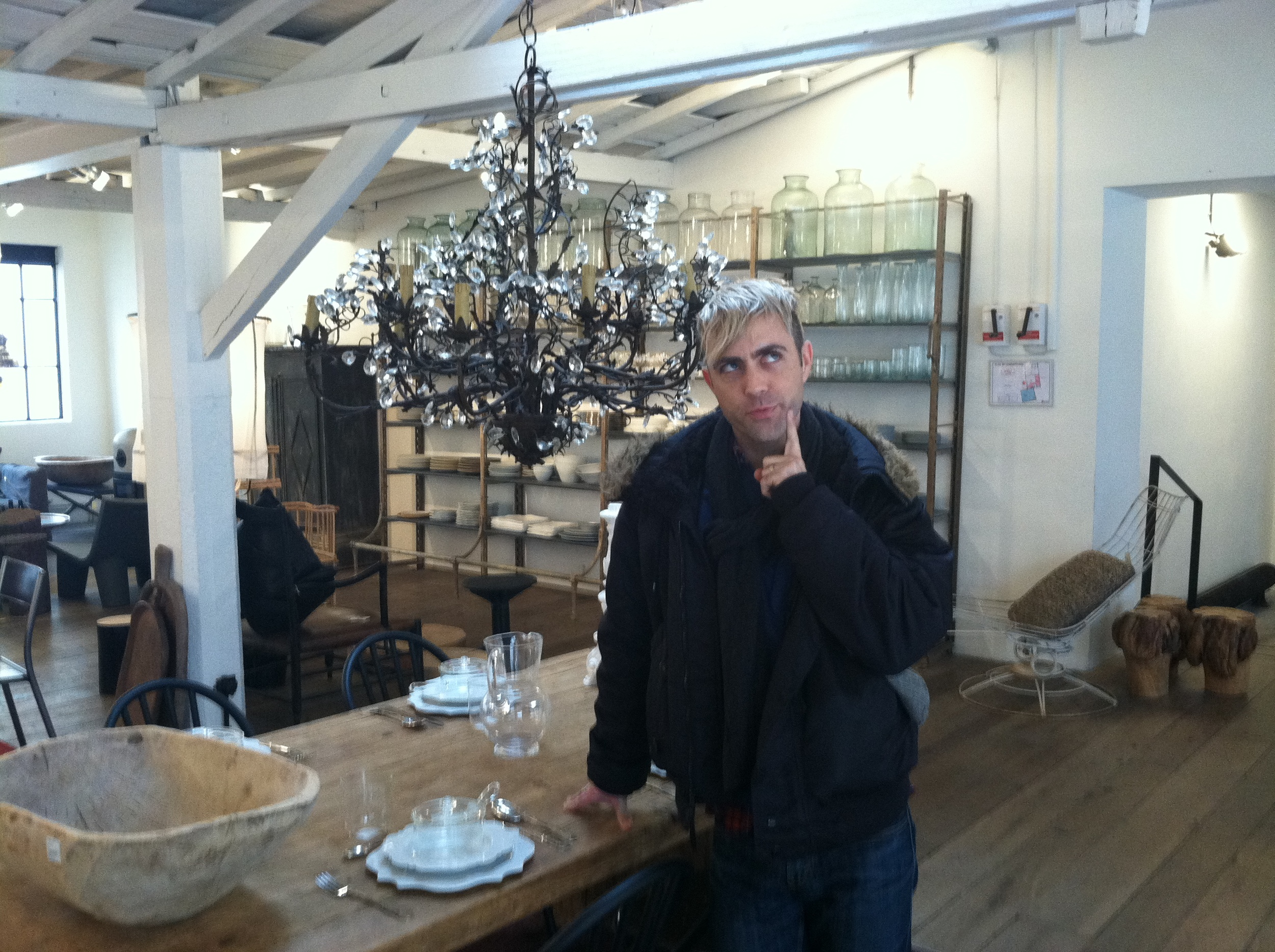 PJ Mehaffey posing in front of dining table inside Merci