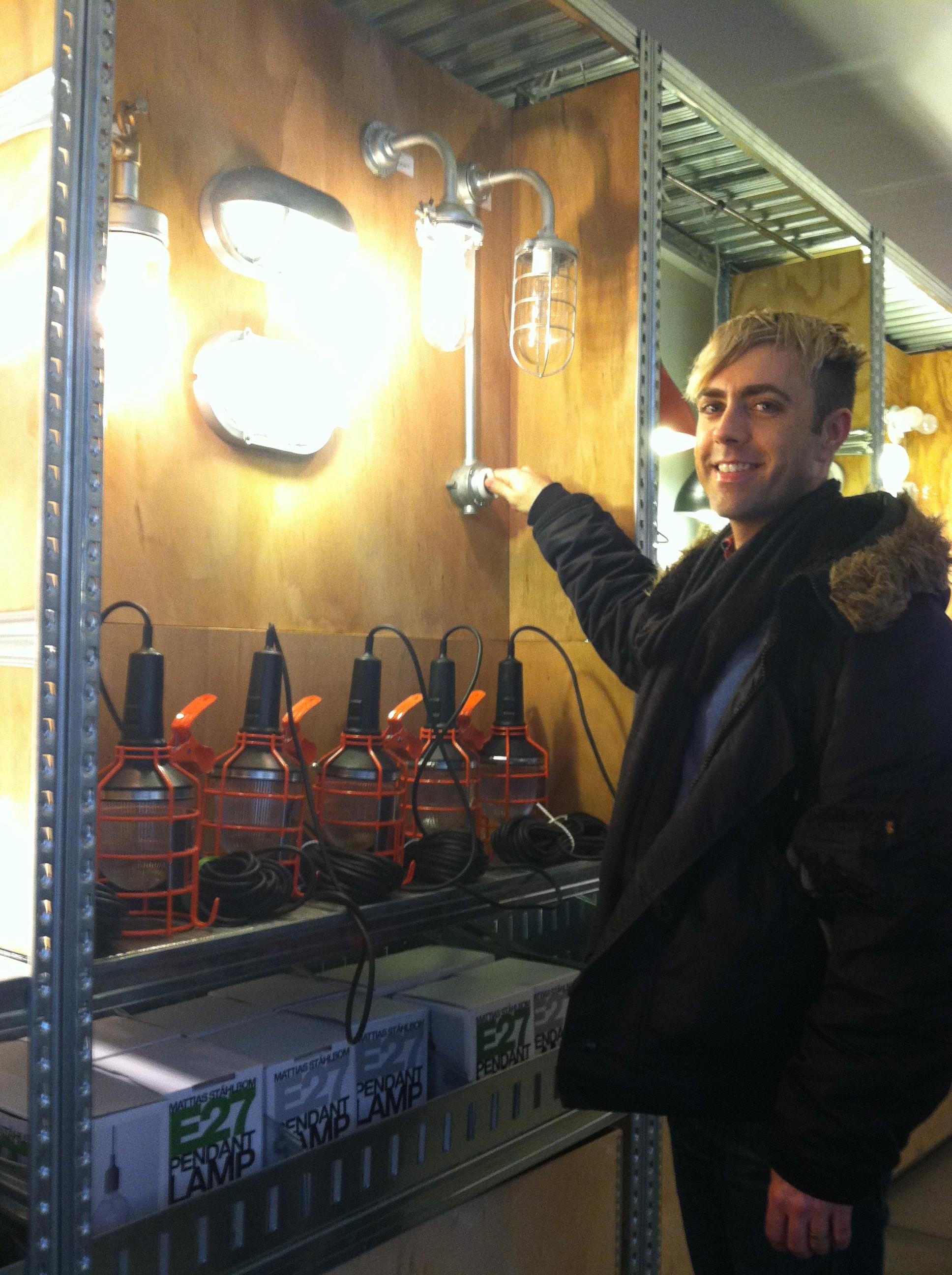 Industrial style light fixture displays inside Merci