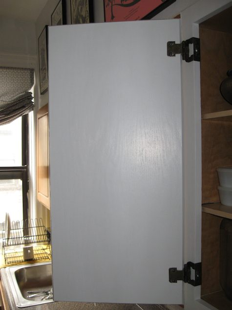 Shot of painted cabinet door open