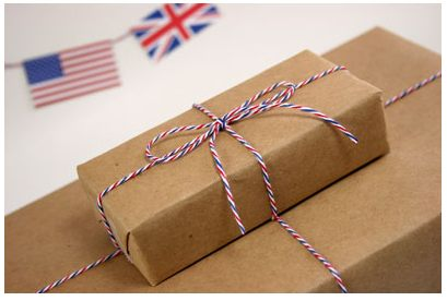 Pic of gifts wrapped in craft paper and red, white and blue twine as ribbon