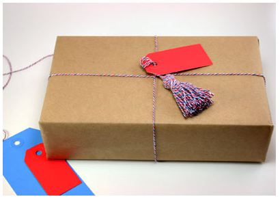 Craft paper wrapped package with baker's twine as ribbon