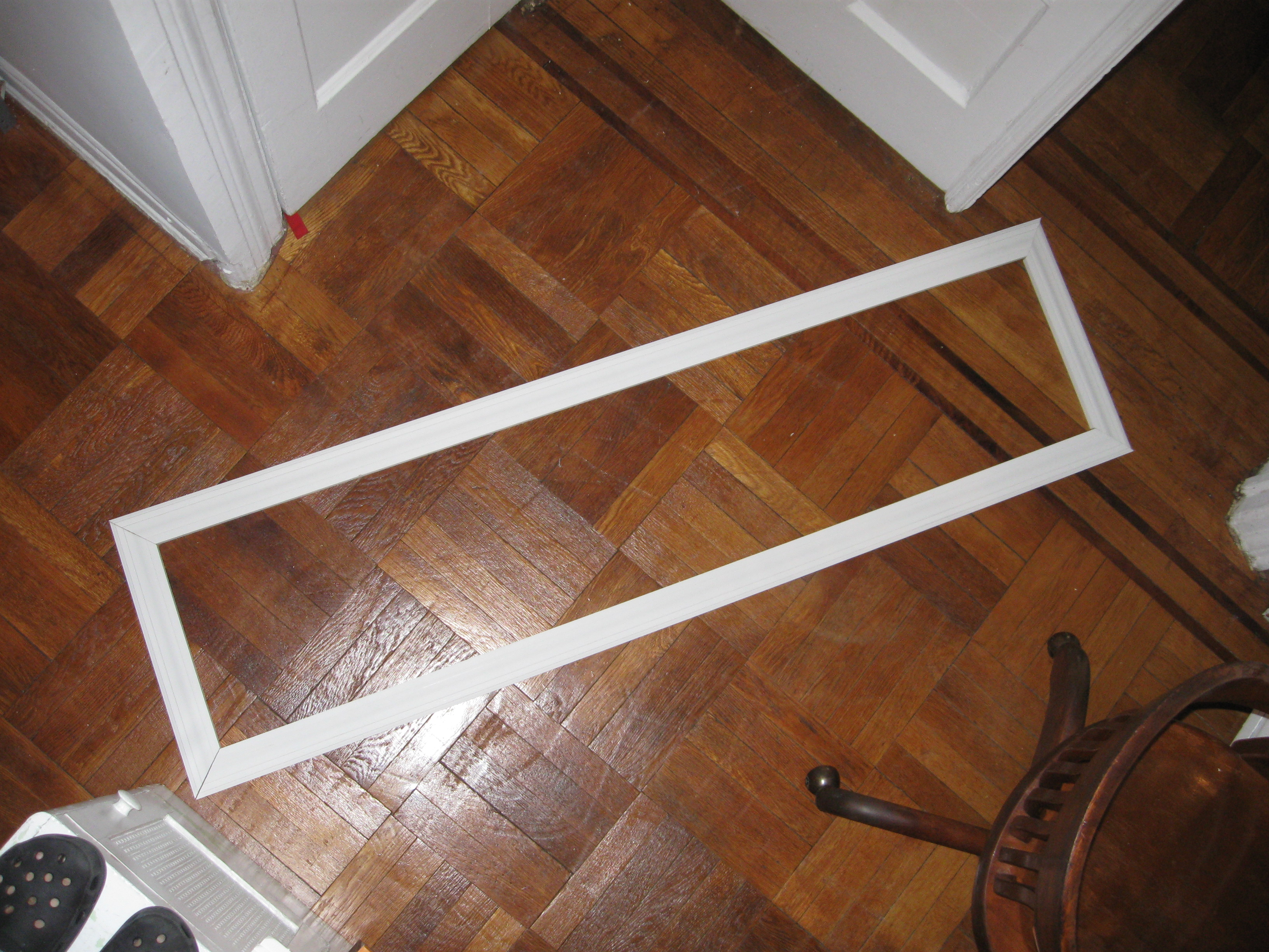 An image shot overhead of white wood trim that's been positioned as a frame