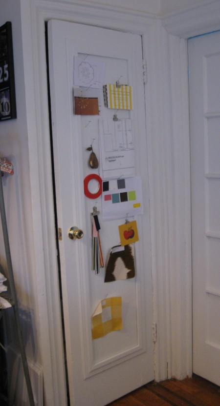 A door that has a custom bulletin board added to inset panel