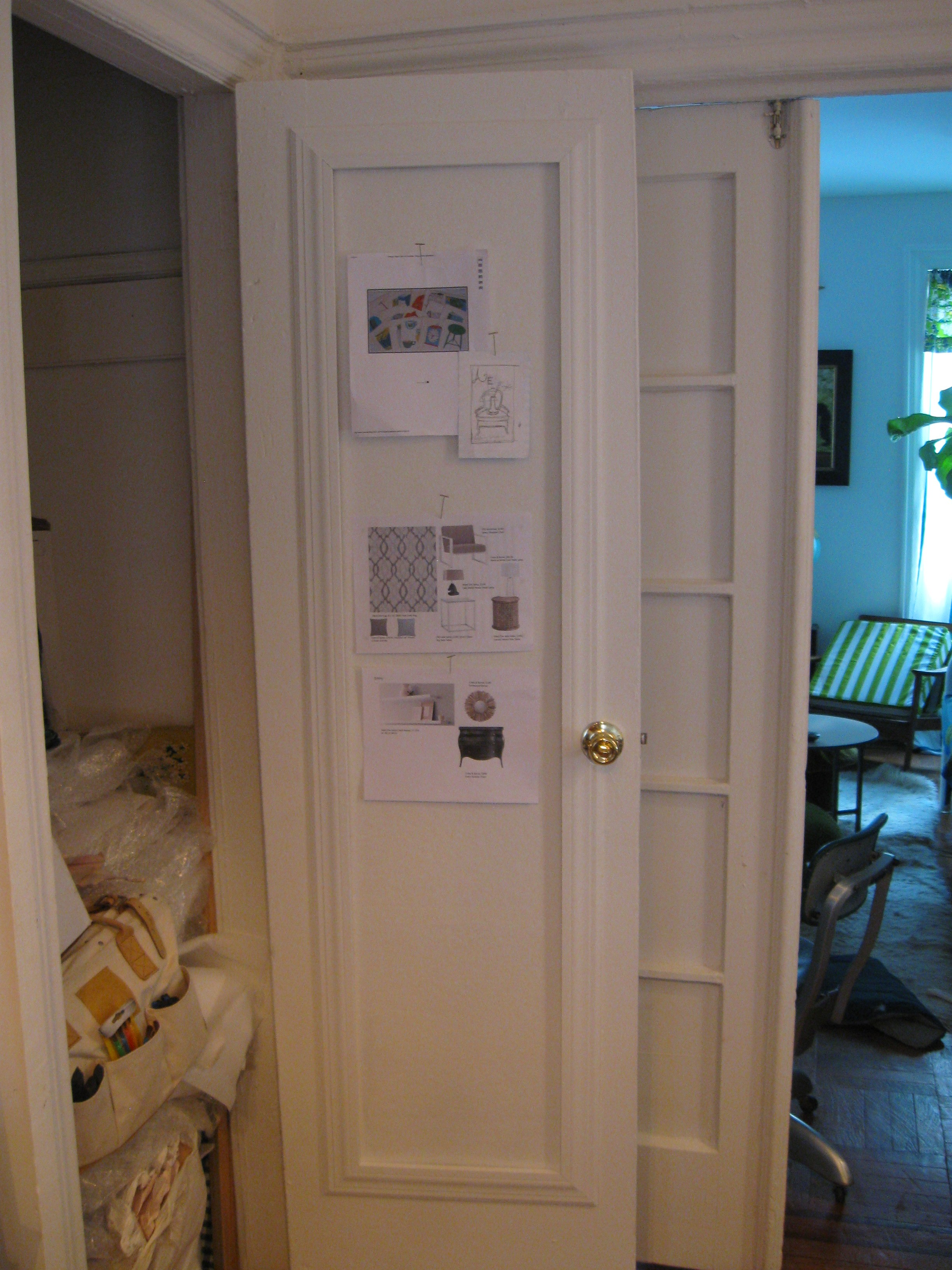 An image of the backside of closet door with competed bulletin board