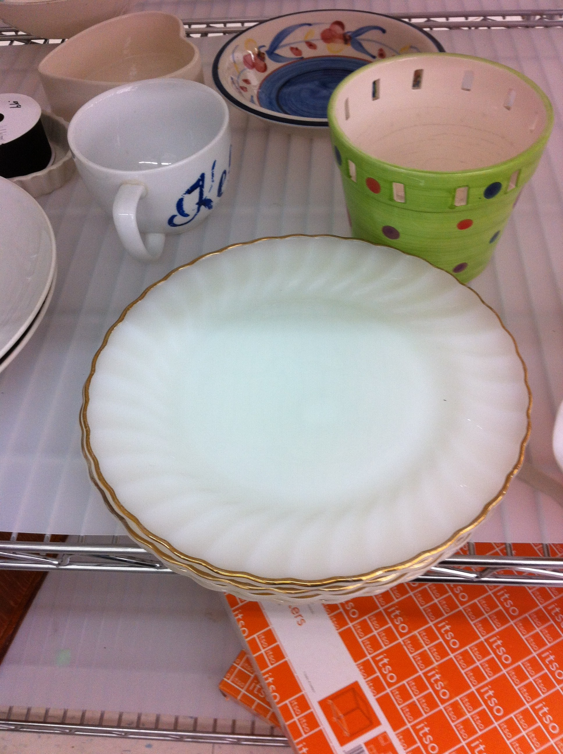 A pic of vintage milk glass plates with gold rims
