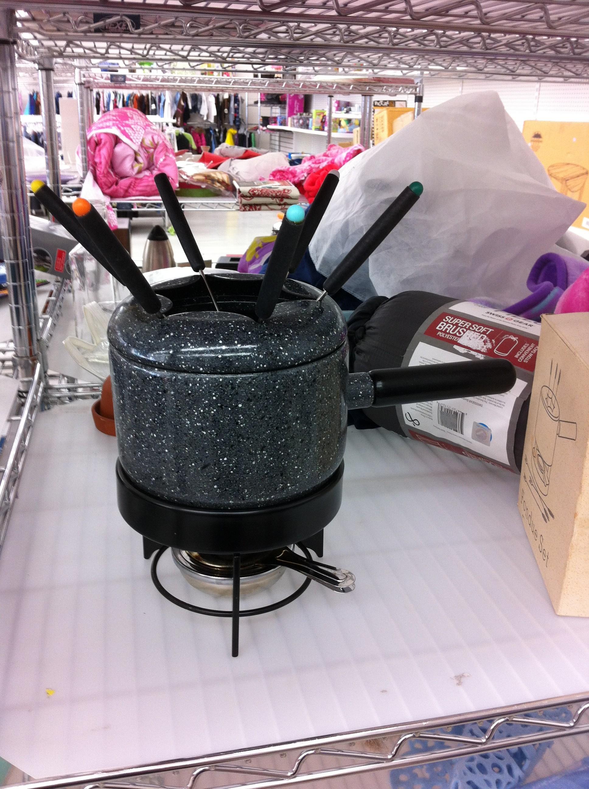 A pic of a vintage black enamel fondue set