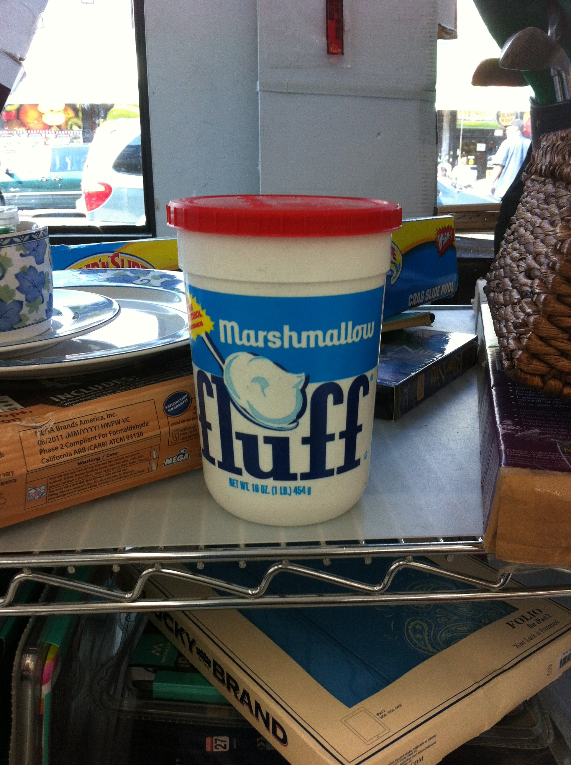 A pic of a tub of Marshmellow Fluff in the thrift store