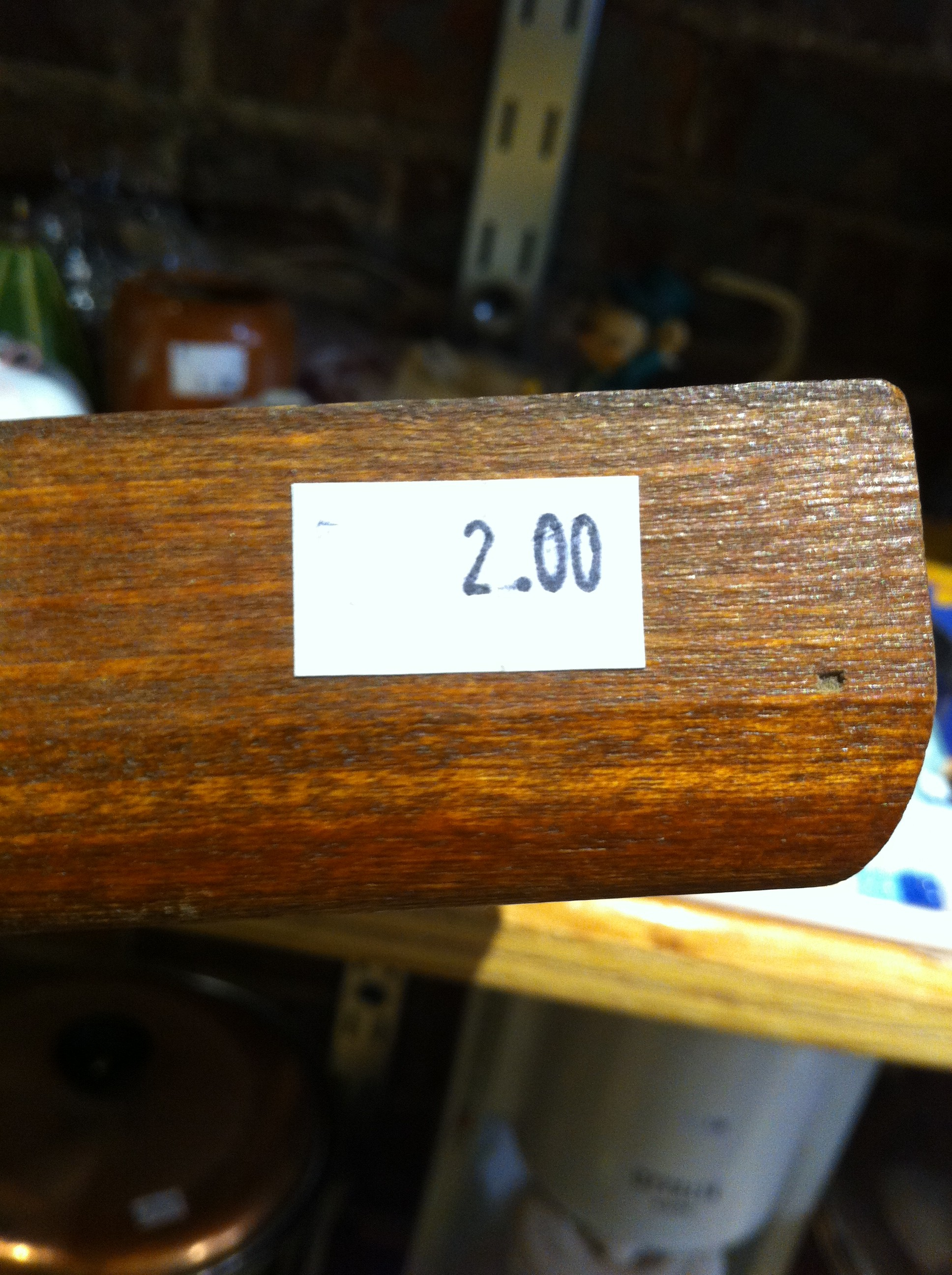 A pic of the price tag on a wooden framed piece of artwork
