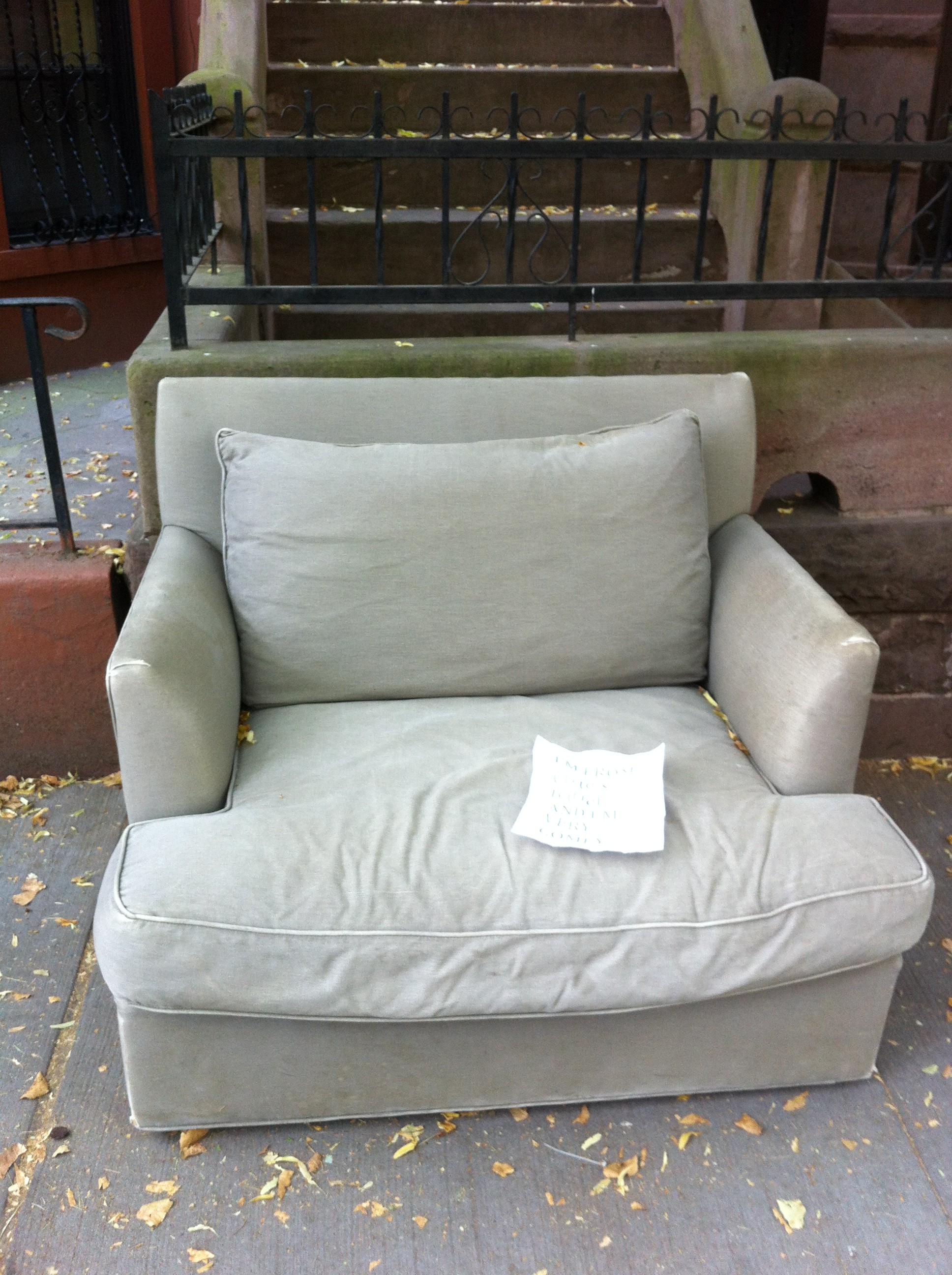 A pic of a chair from Crate & Barrel on the curb in NYC