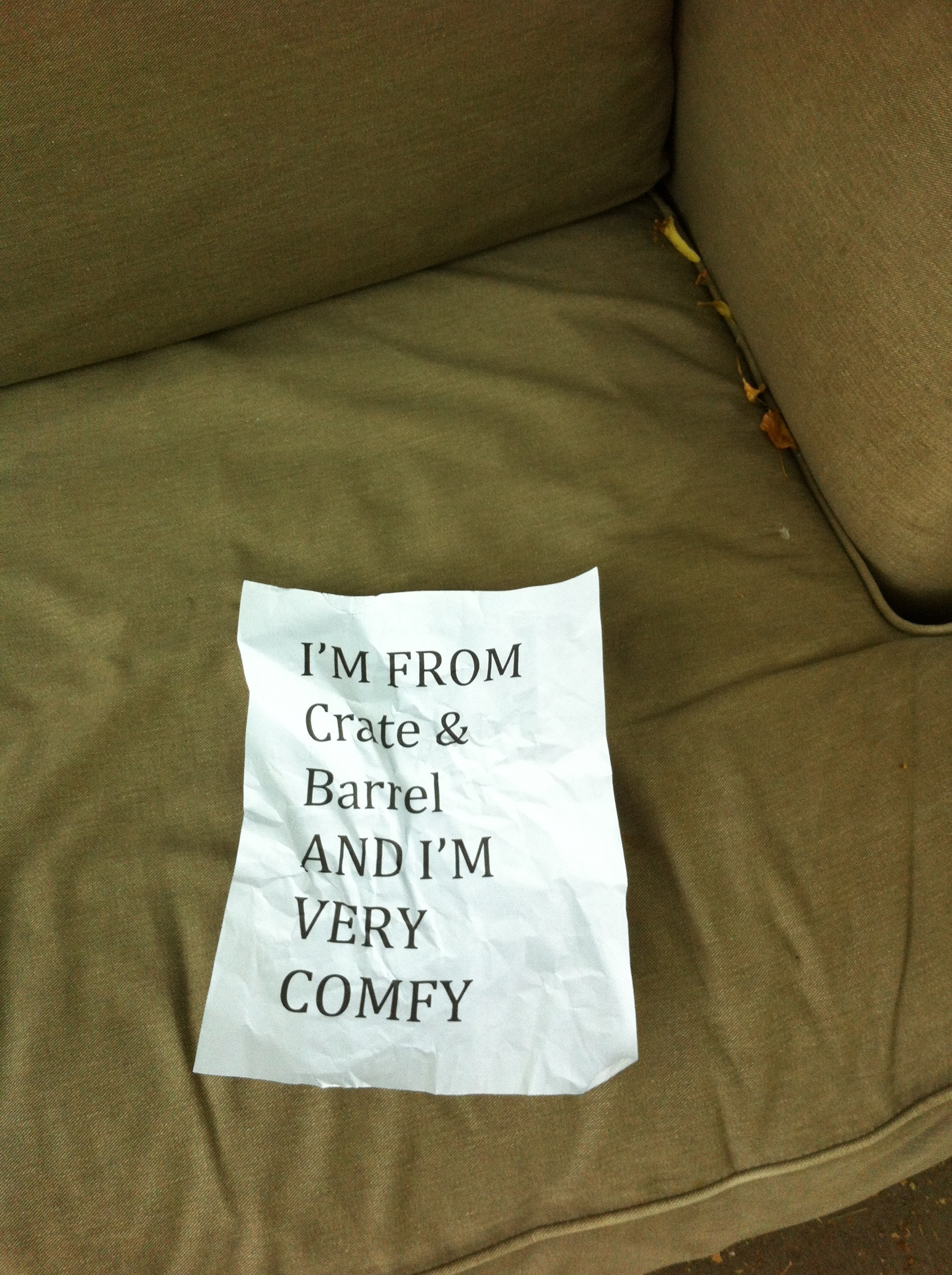 A pic of a sign in the seat of the Crate & Barrel chair