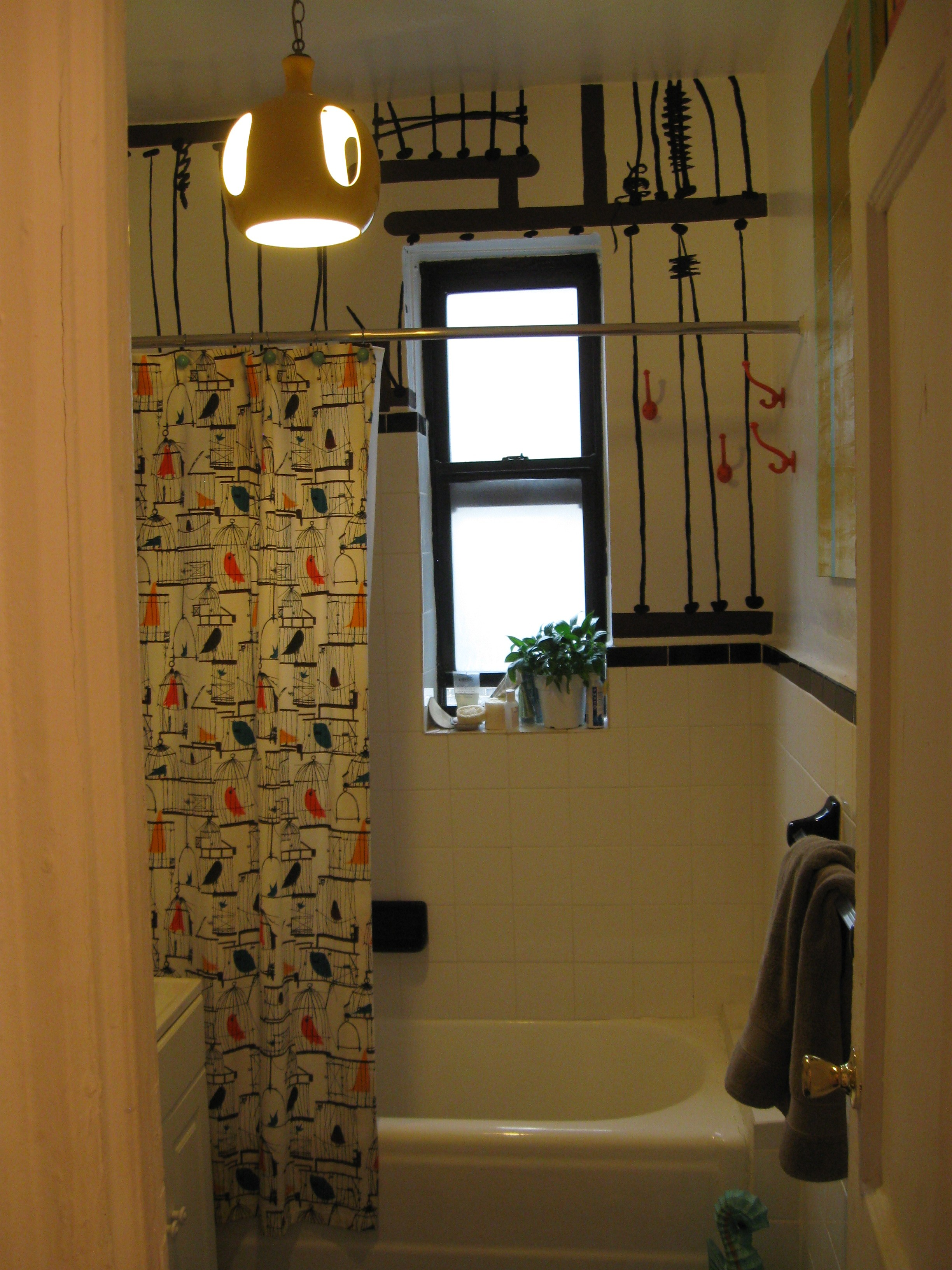 A pic of the bathroom after being painted in stylized pattern