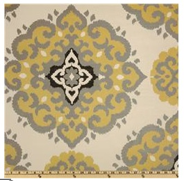 An image of a yellow and black medallion print fabric
