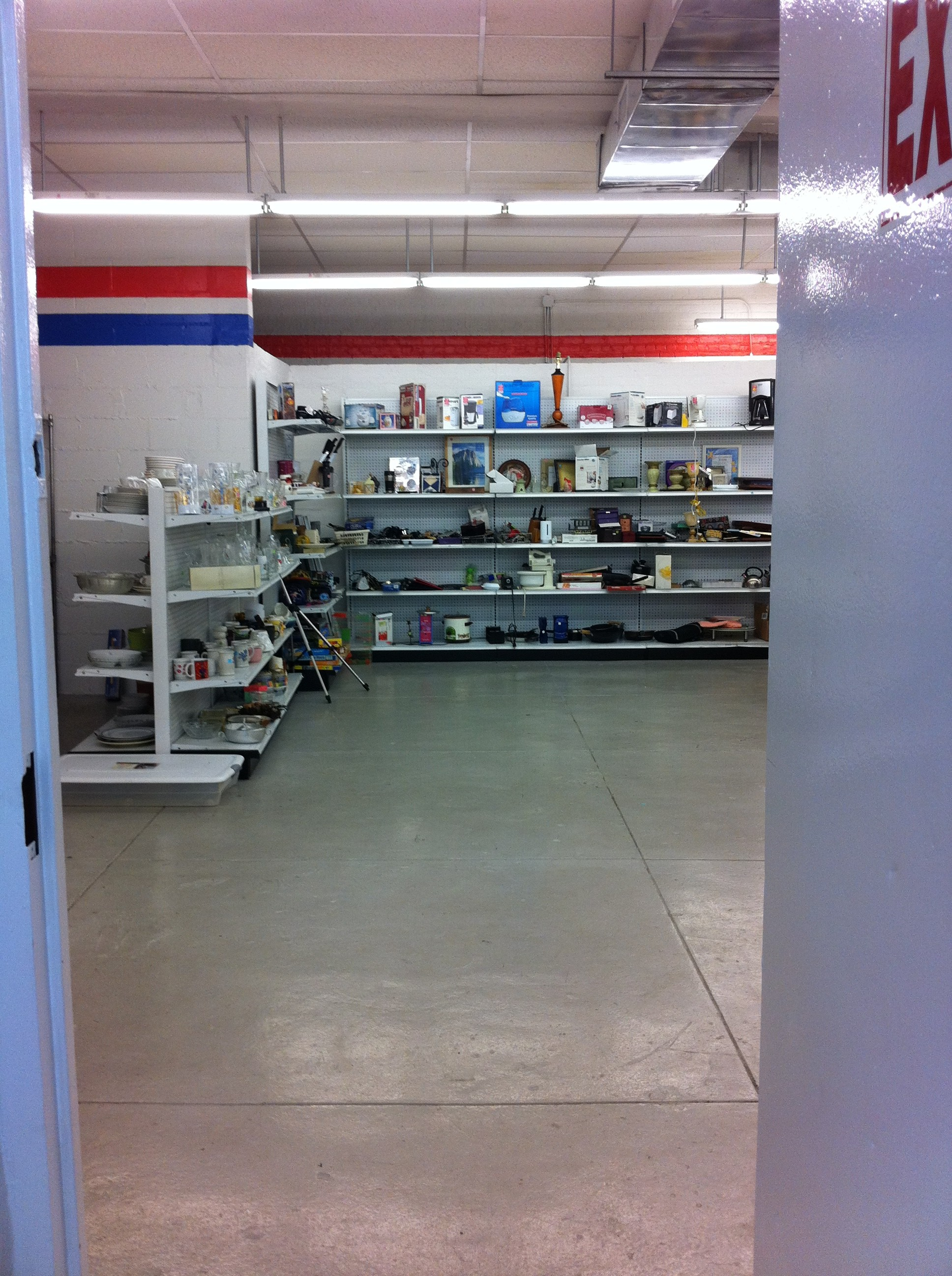 An image of the housewares shelves at the local Salvation Army