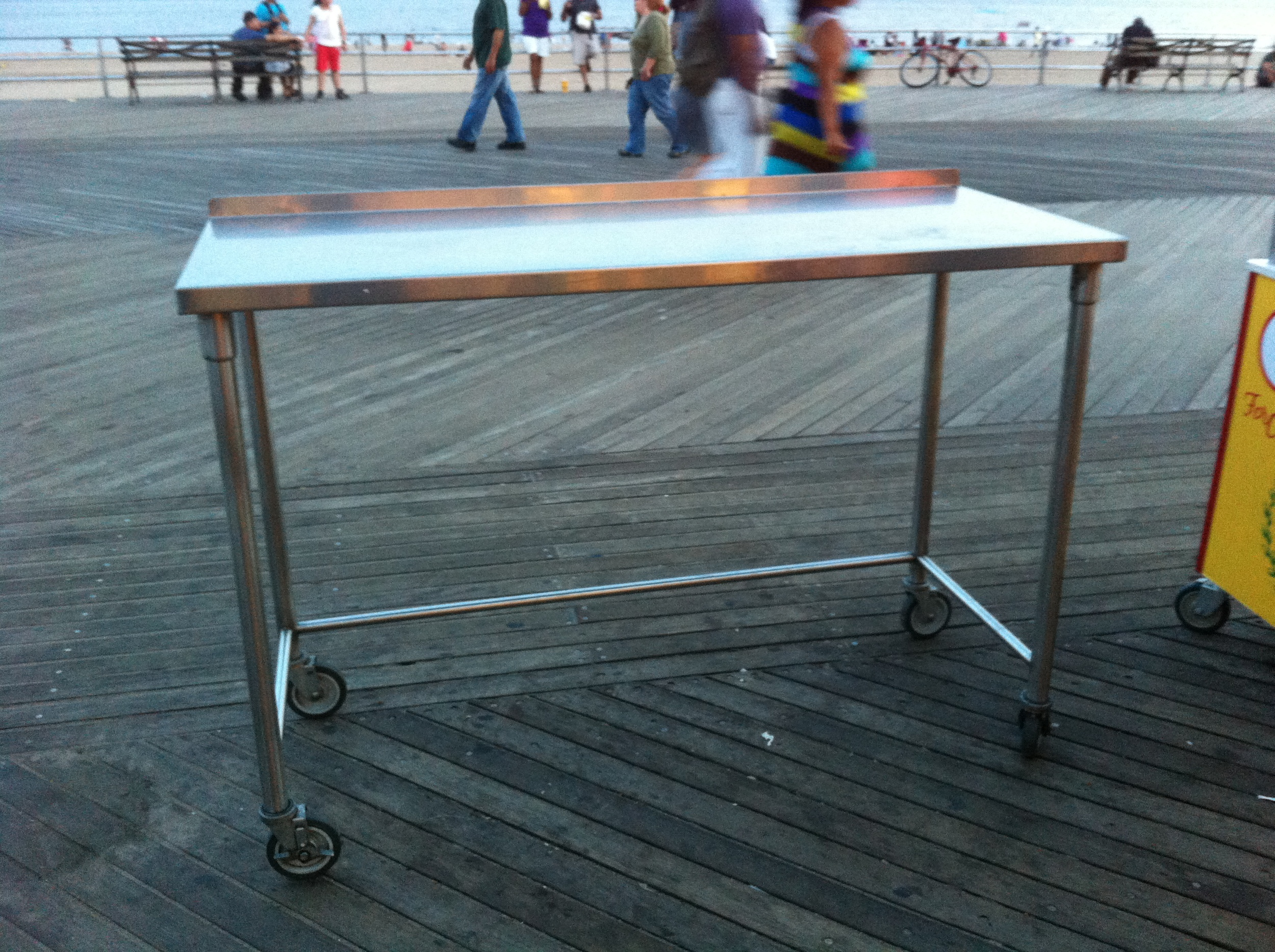 A shot of a stainless steel restaurant table with an 'open base'