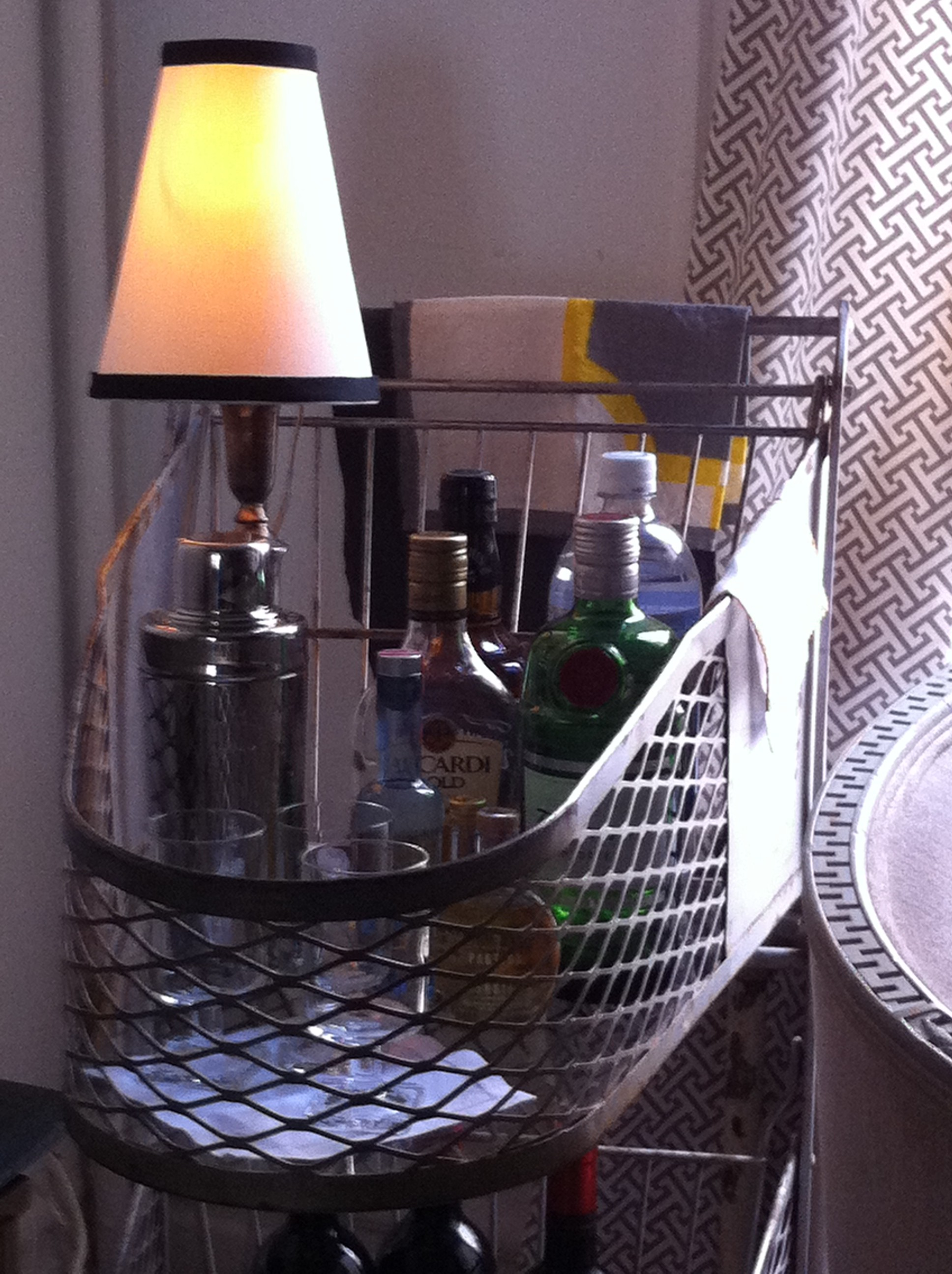 A close up shot of the top tier of repurposed bar cart