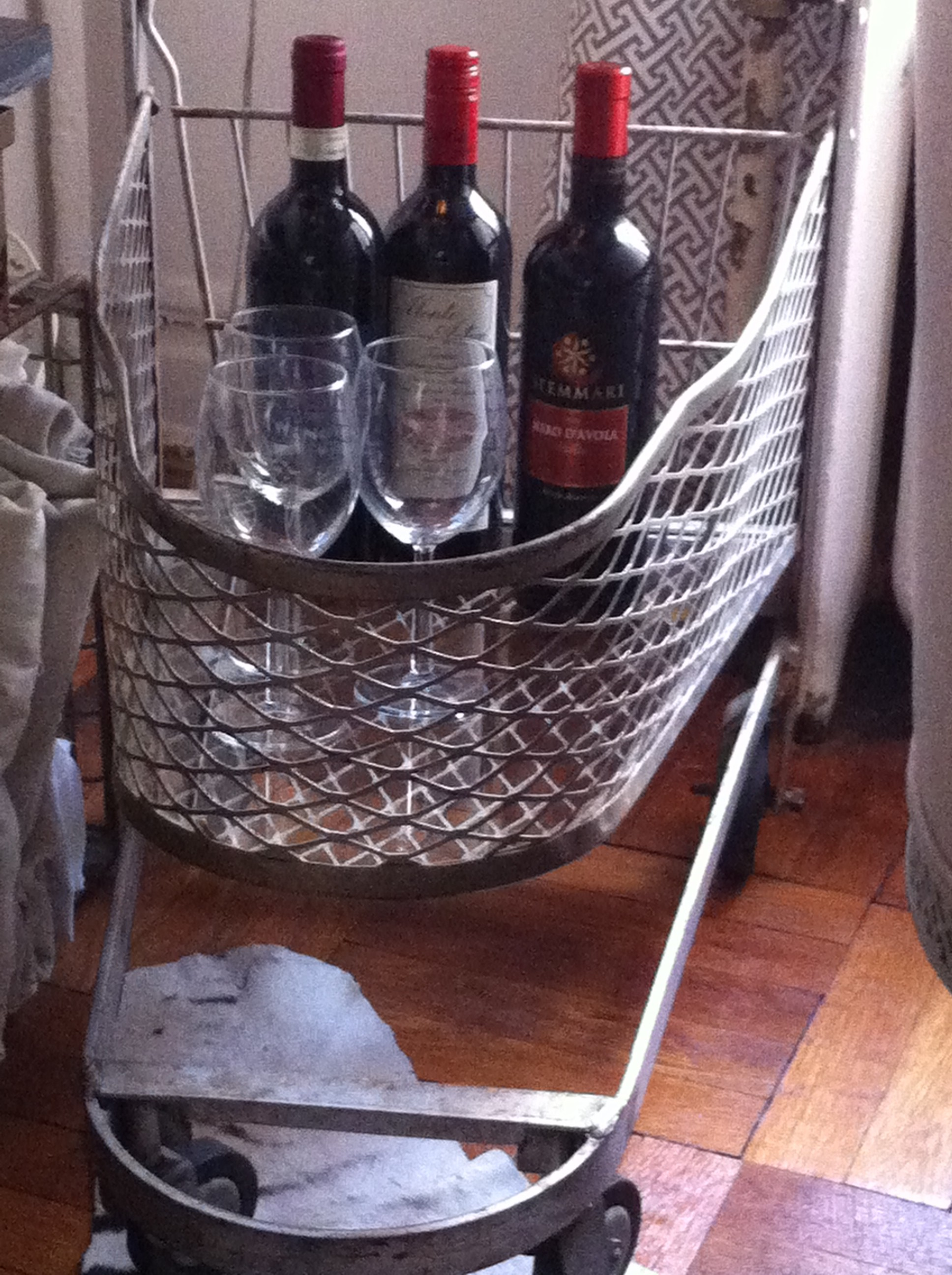 A pic of the lower tier of the repurposed bar cart