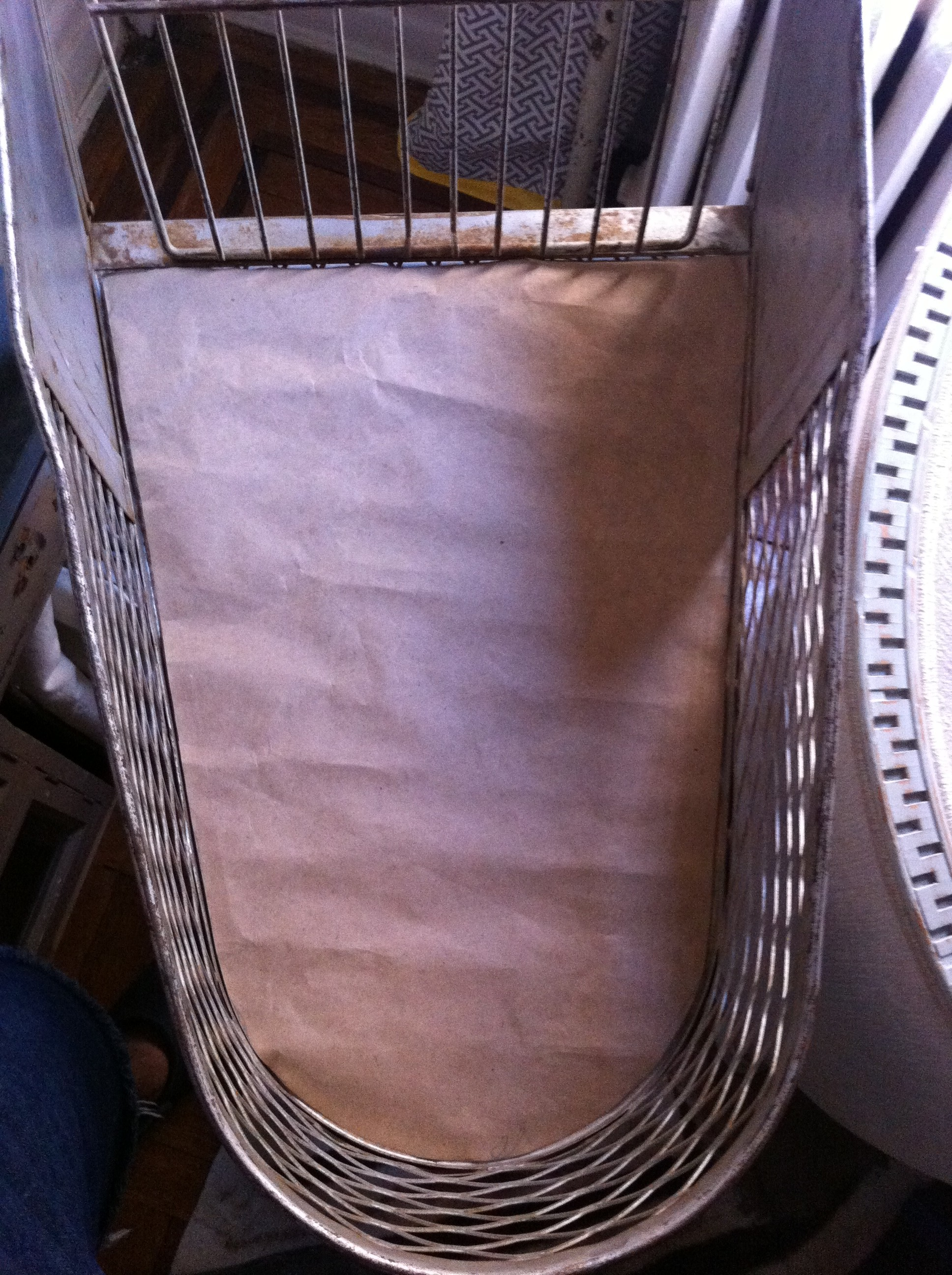 A pic of the paper template fitting perfectly into the base of basket