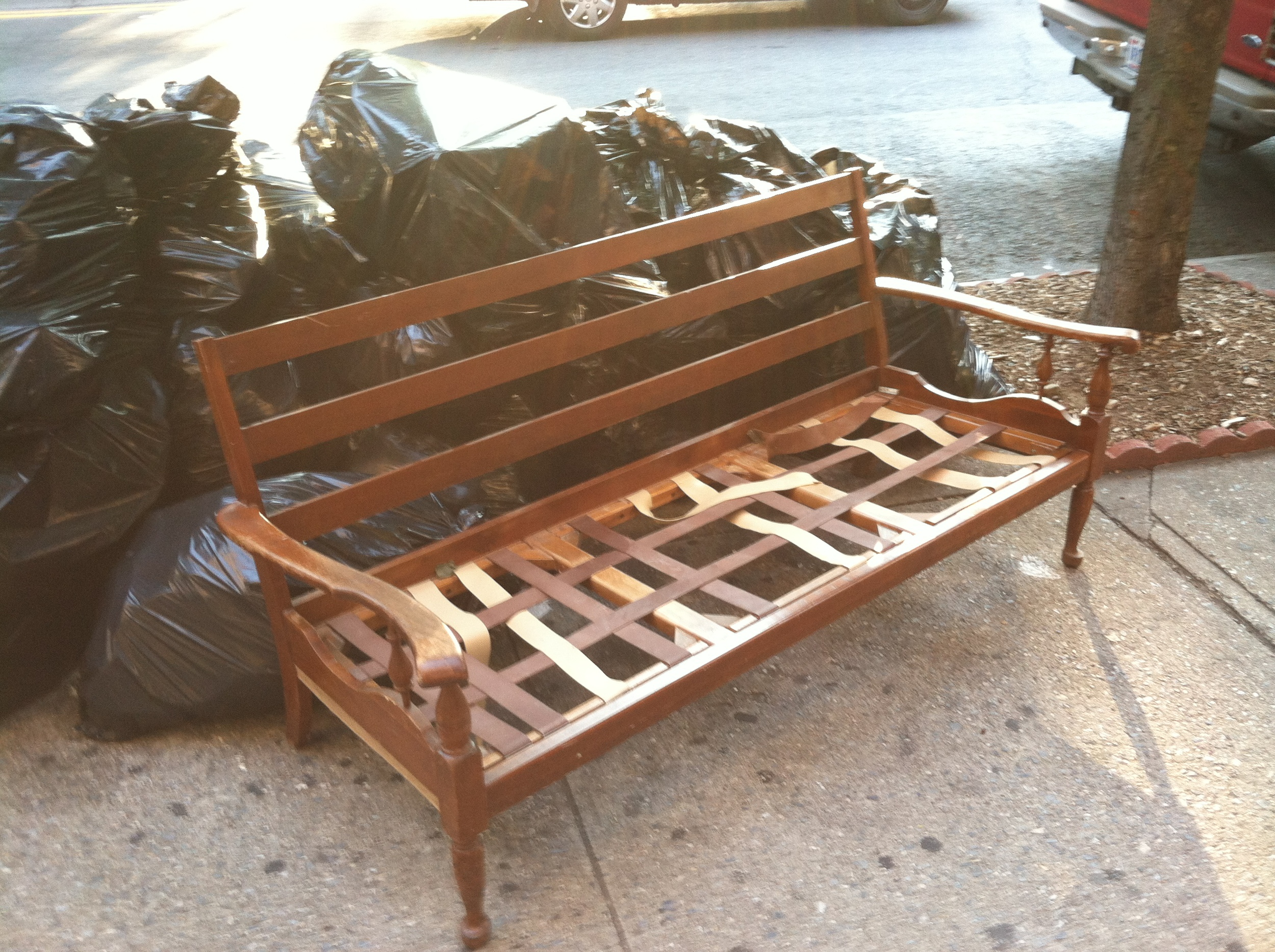 Another pic of the wood framed settee discarded in the garbage