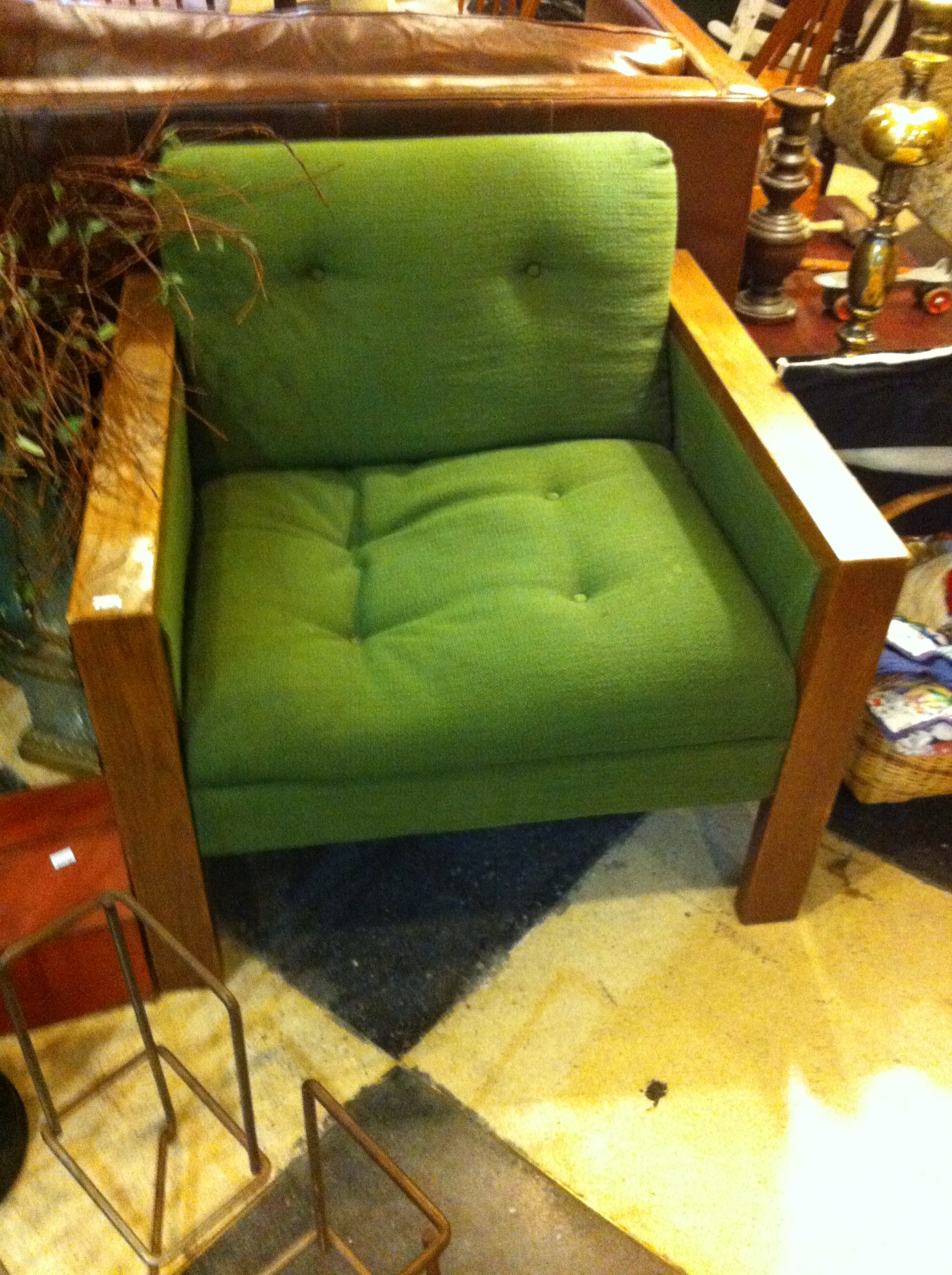 Mid century green upholstered chair with wood trim