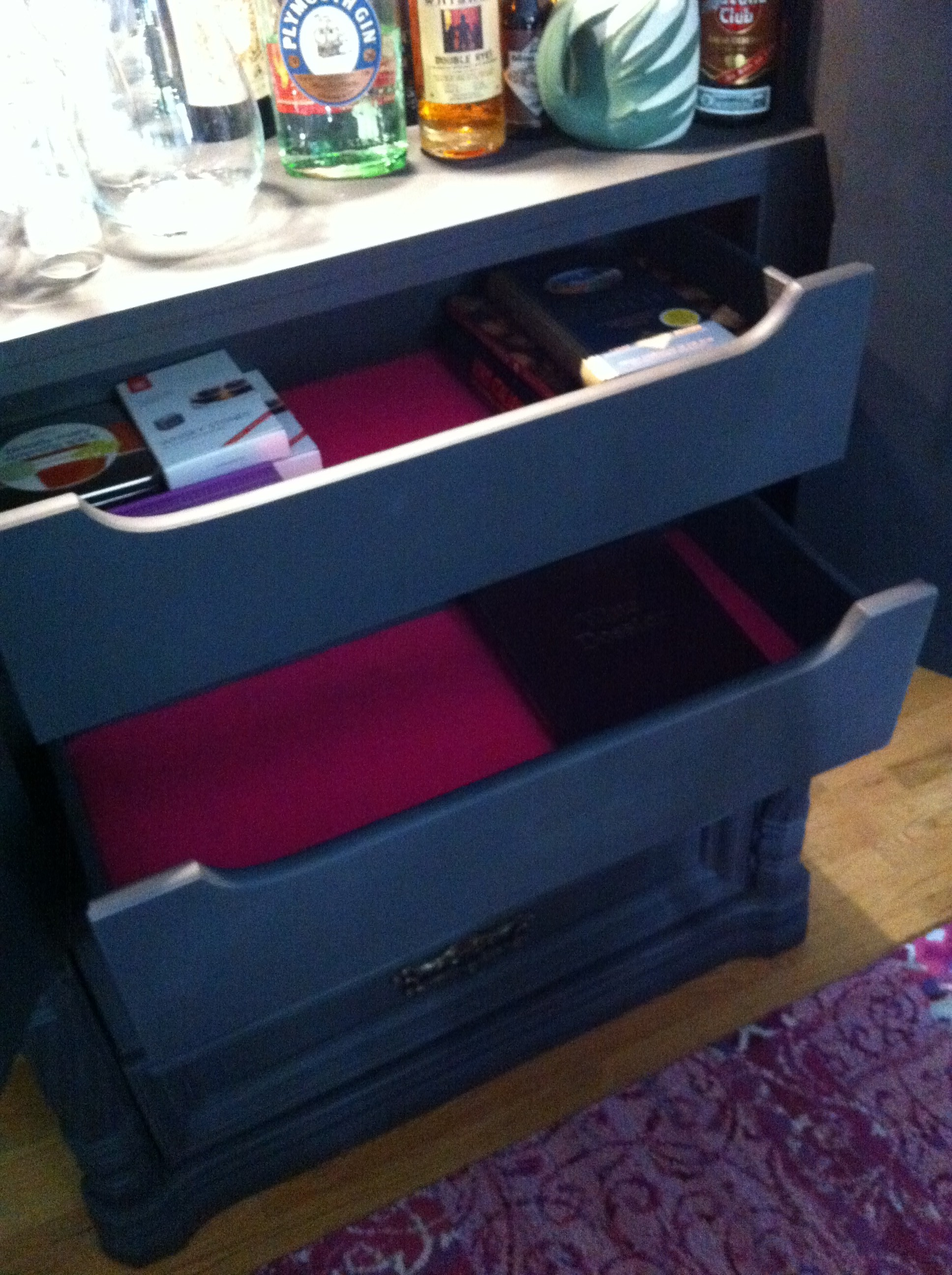 A close up shot of drawers lined in pink felt