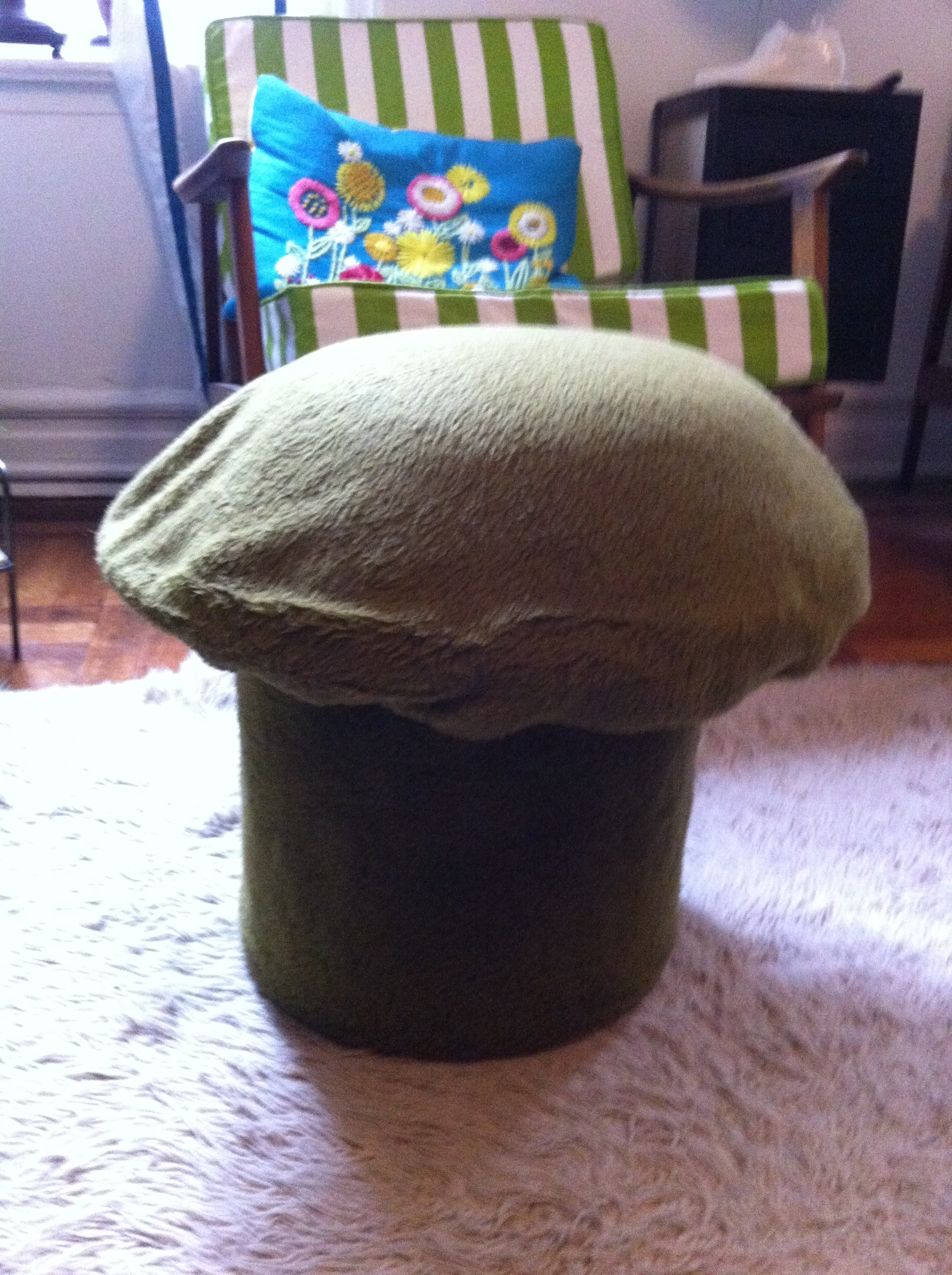 A close up of 2nd mushroom shaped ottoman