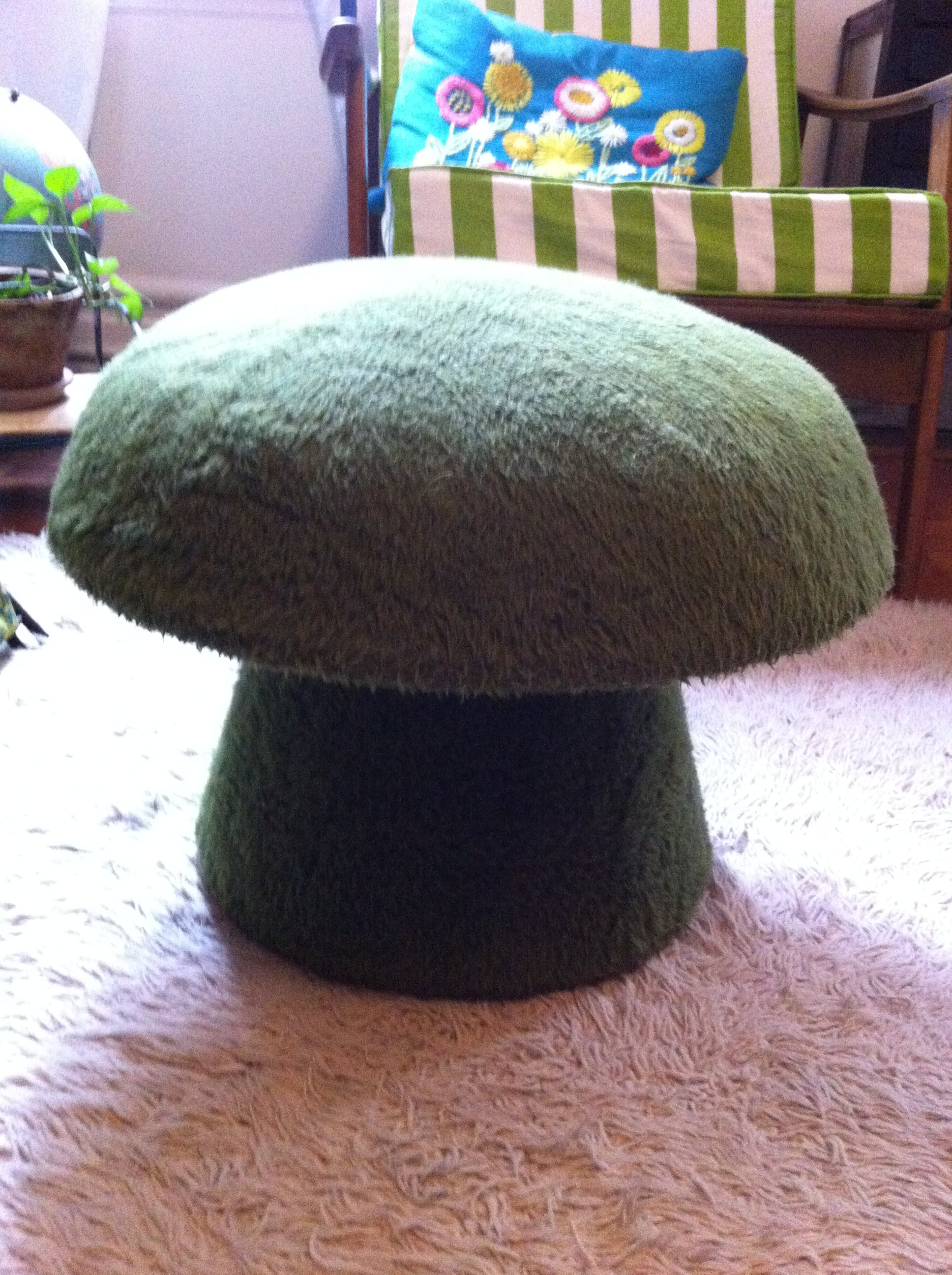 A close up pic of 1 of 2 mushroom ottomans