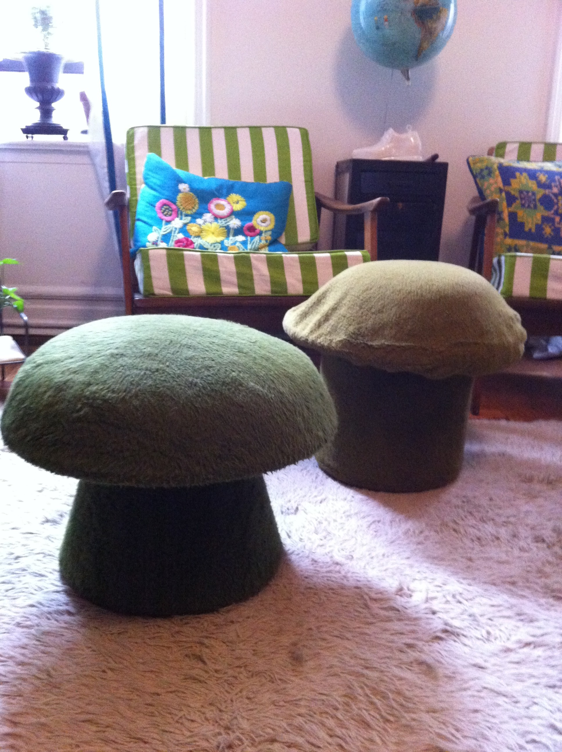 A pic of two mushroom shaped ottomans