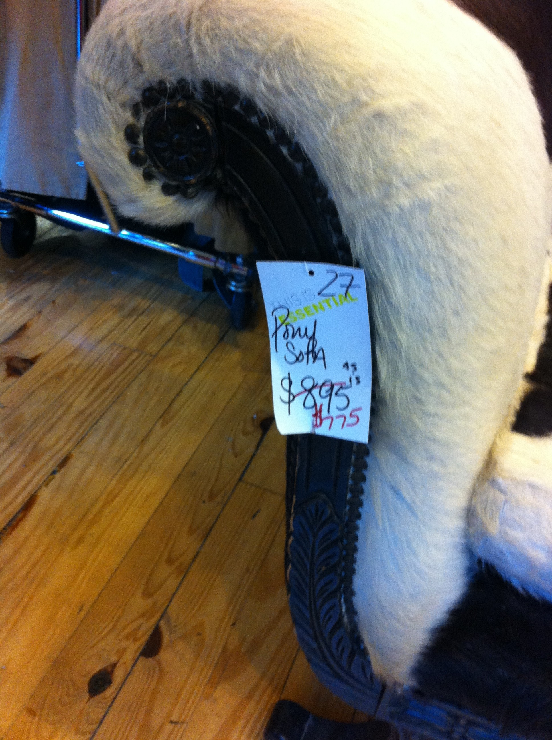 A tight pic of the sales tag for a vintage pony covered settee in thrift store