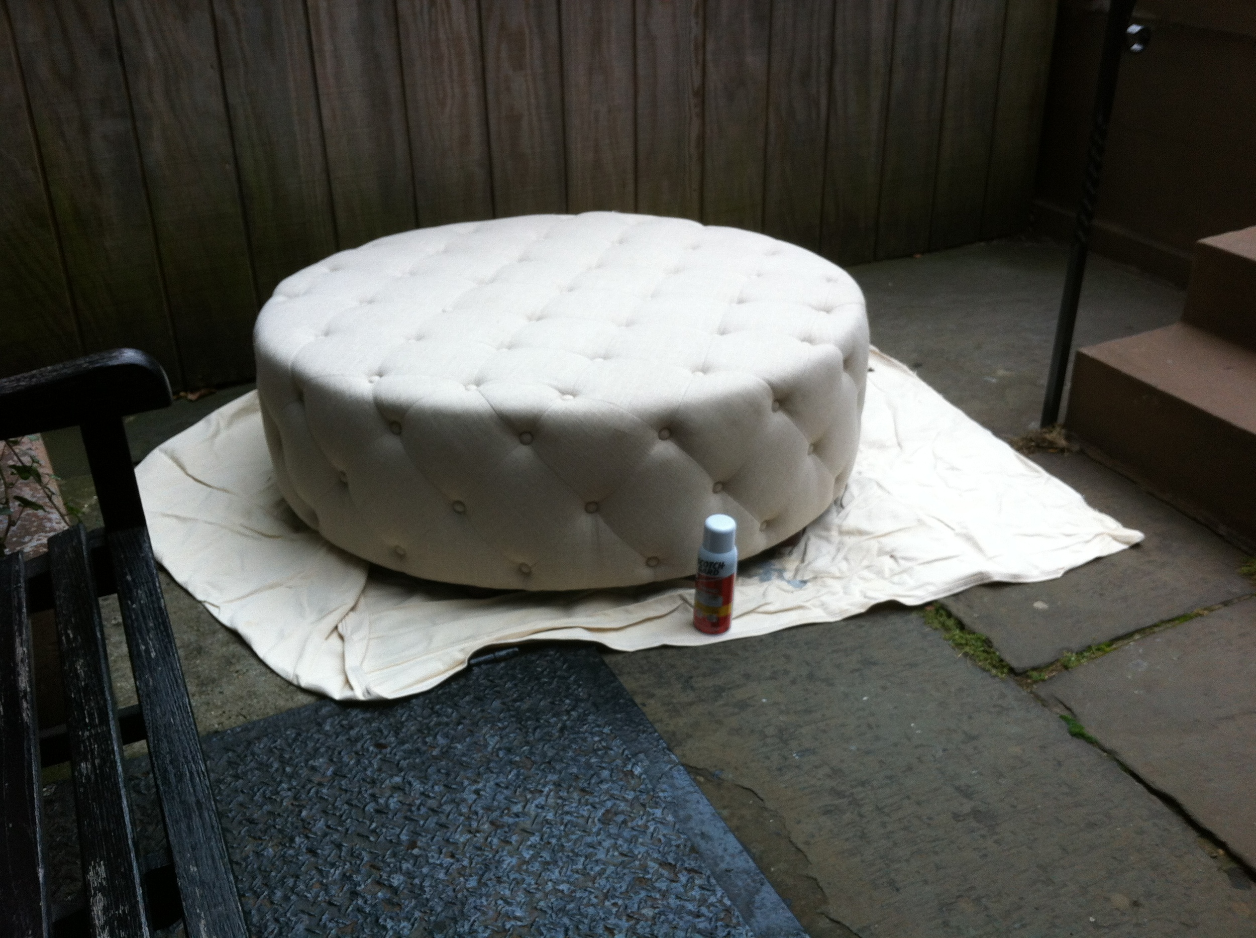 An alternate view of light colored ottoman for client