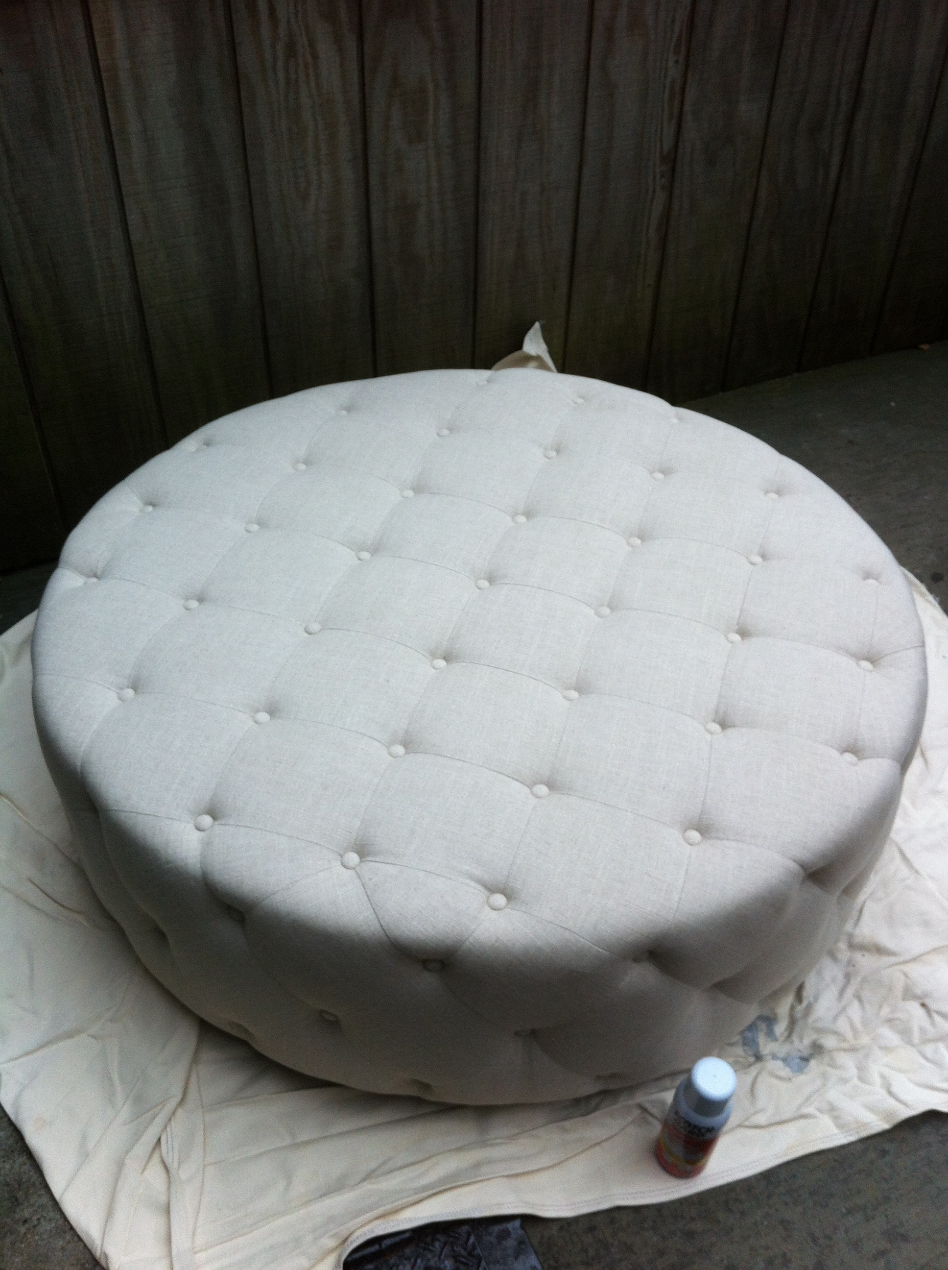 A pic of a large light upholstered ottoman for PJ Mehaffey's client